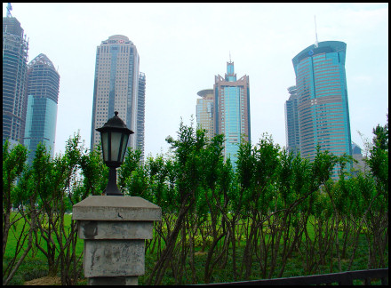 Greenery and buildings in the distance